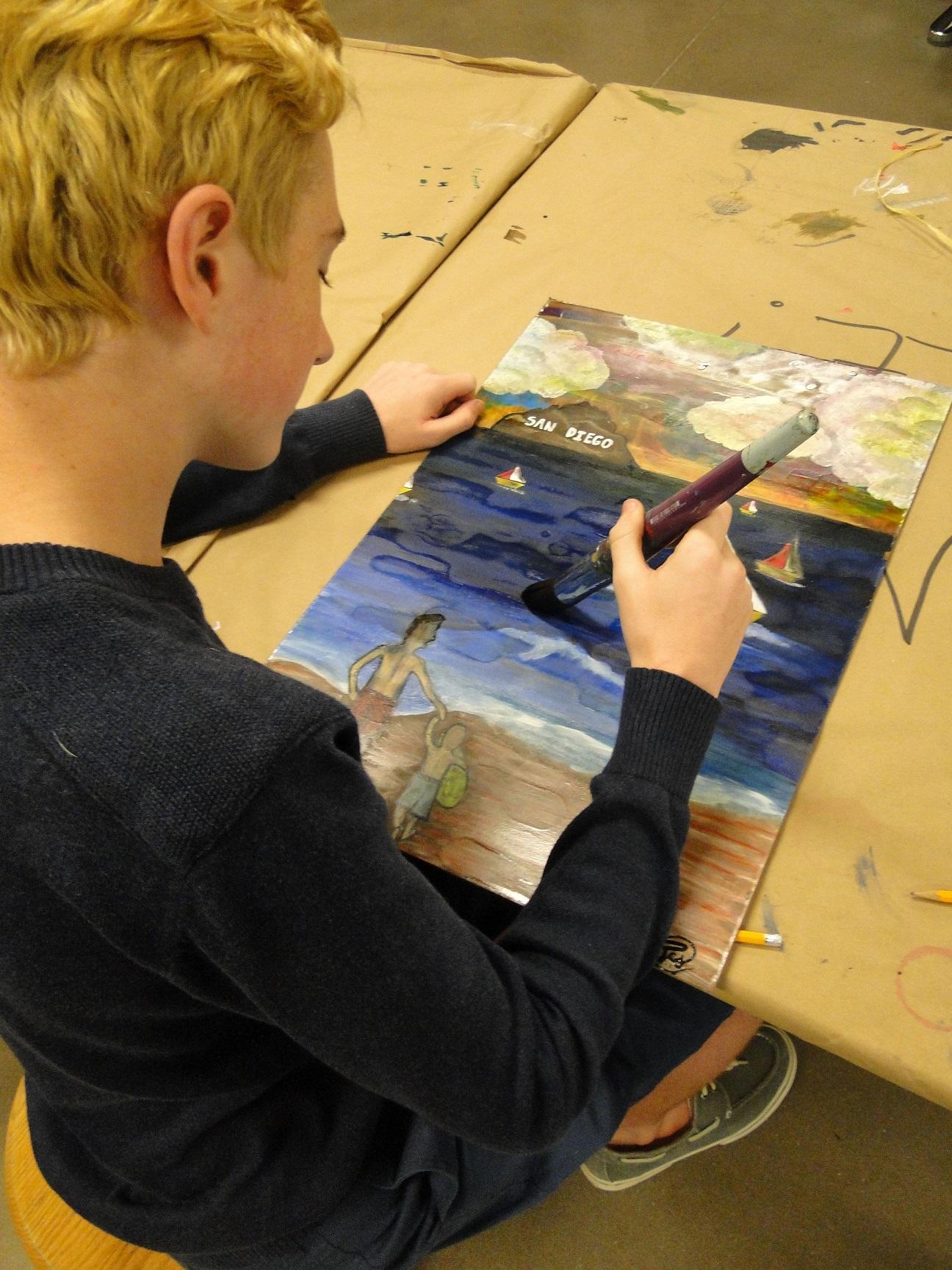 Jack Schmeiser works on a piece for PE teacher Christopher Baroz.