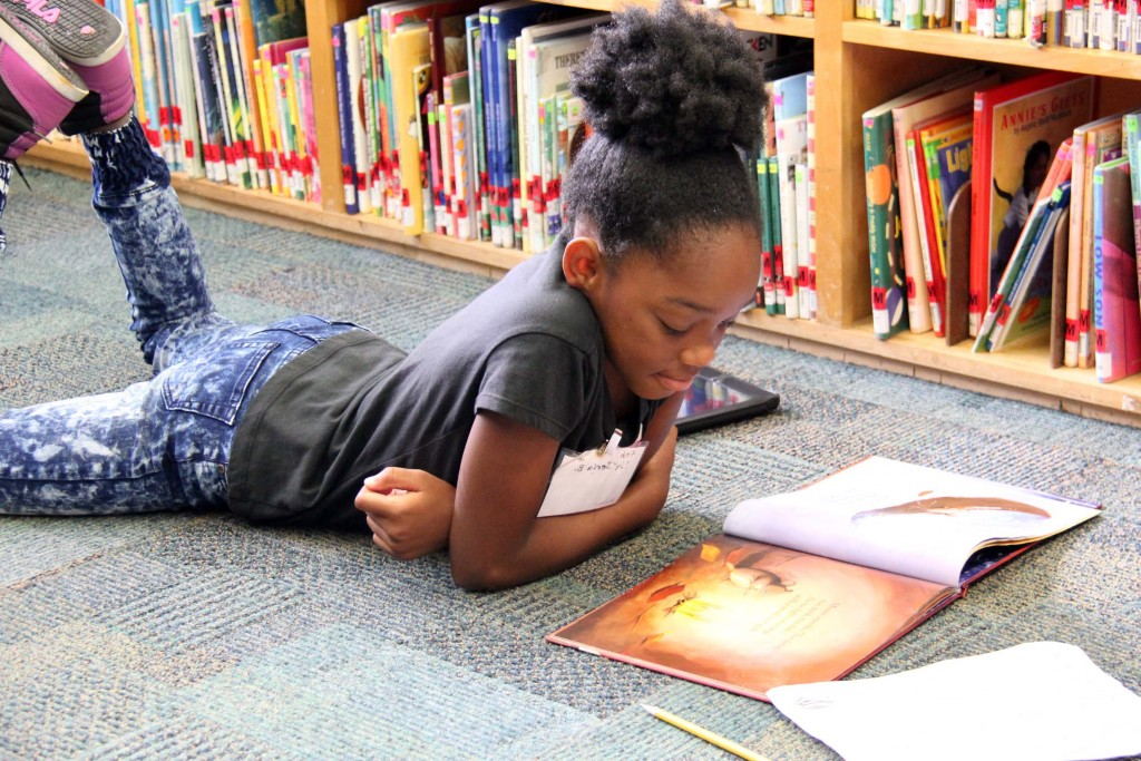 Nyjeria reads in the school library.