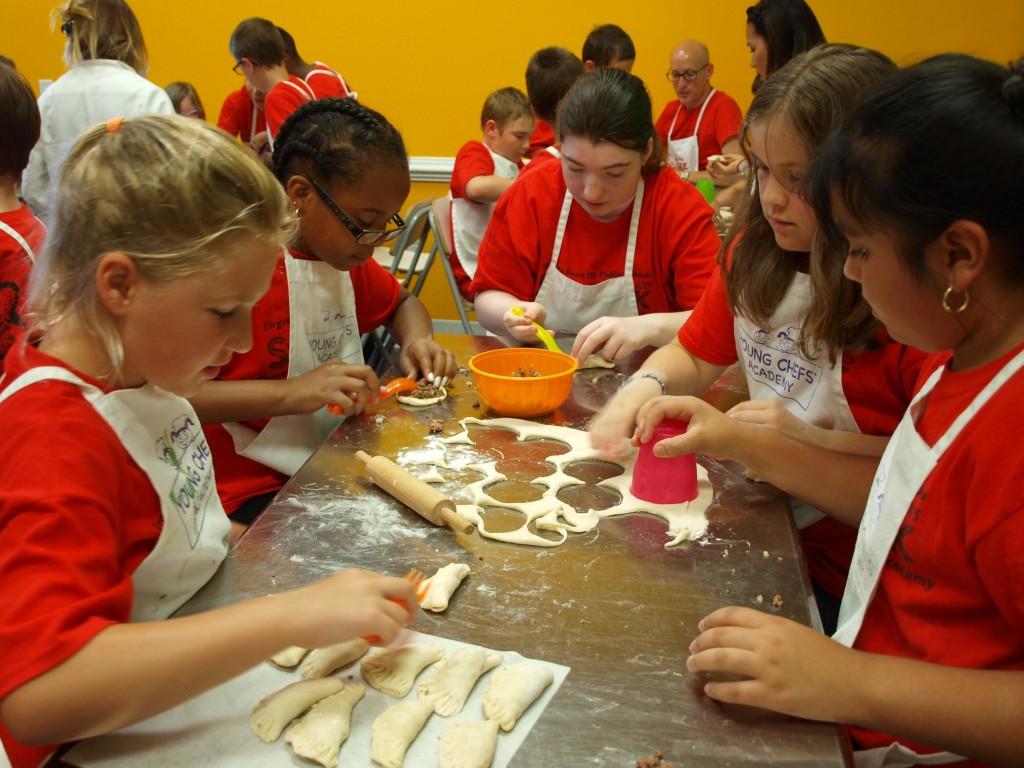 Students prepare Russian dumplings.