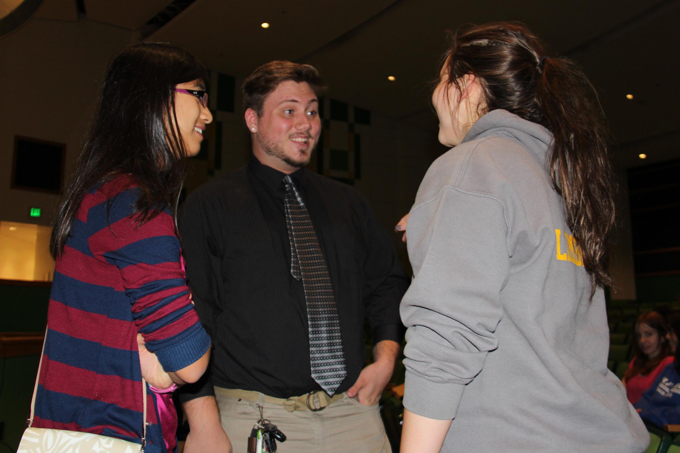 MSA graduates Anna Phan and Ryan Kilduff talk to MSA students.