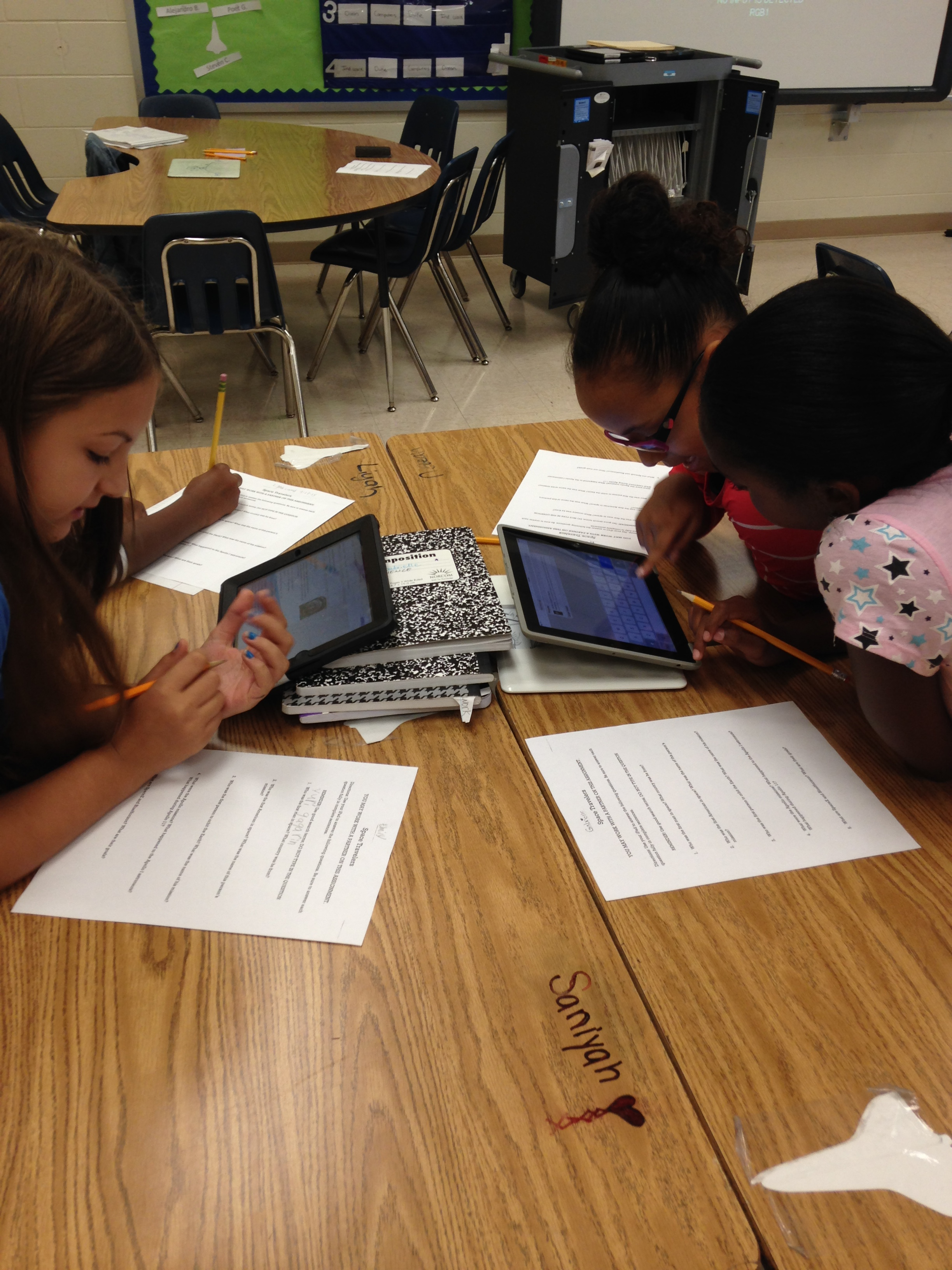 Fourth Graders  Emily Vogel, Neveah Billups and Gabrielle Dixon work on their project.