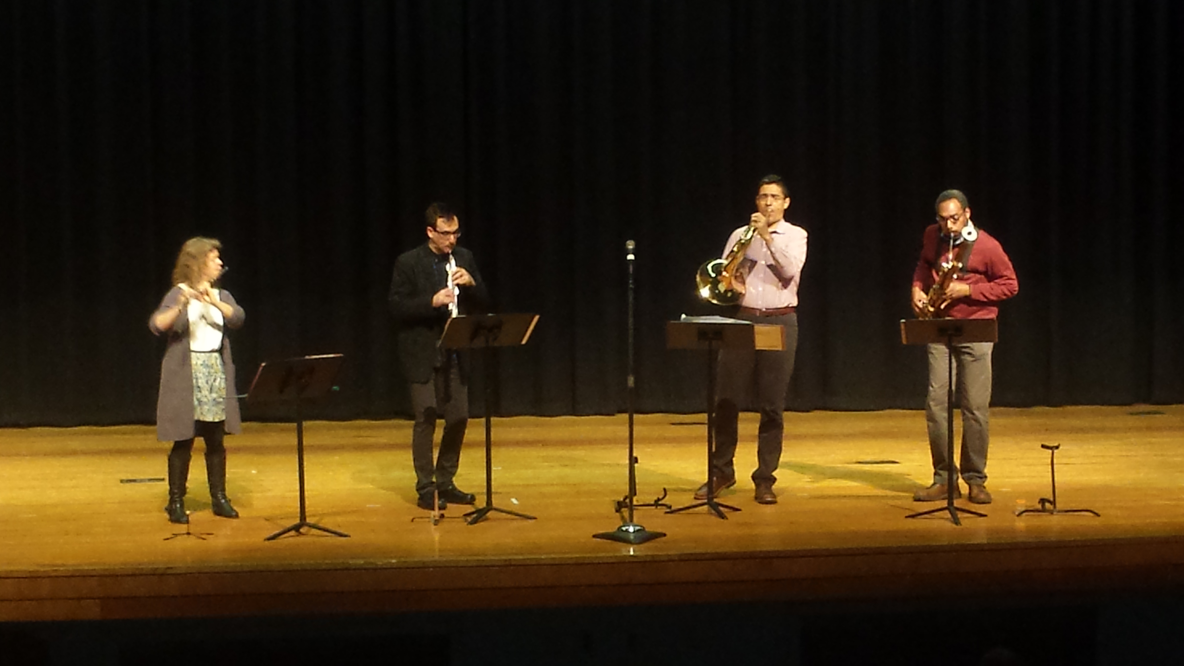 Quinteto Latino members perform for Plaza Middle School music and Spanish classes. Members include Diane Grubbe on flute, Kyle Bruckmann on the oboe, Armando Castellano on French horn, and bassoon player Shawn Jones.