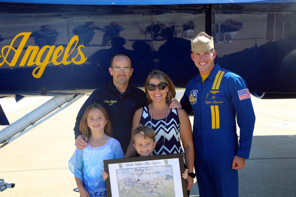 Bradley Ward and his family stand with Blue Angel No. 7 pilot Lt. Tyler Davies.