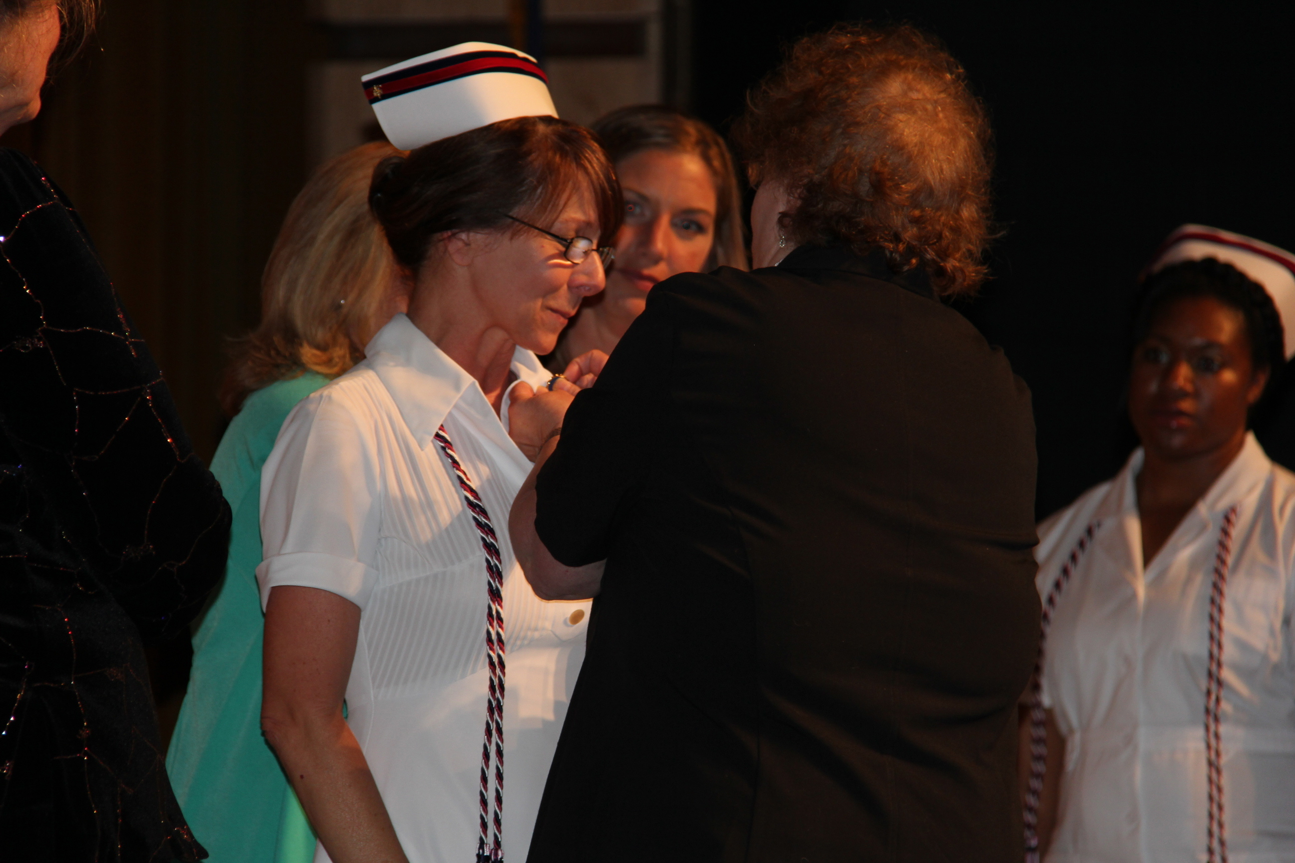 Jethro receives lapel pin at graduation