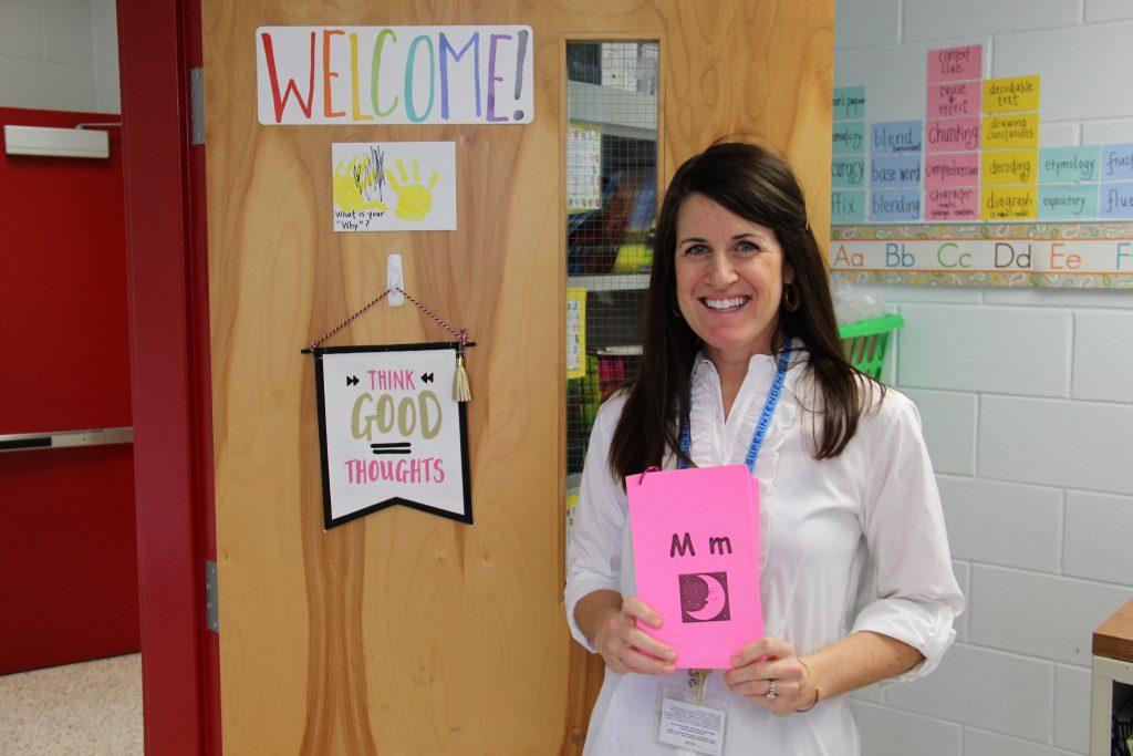 Teacher holding M pronounciation