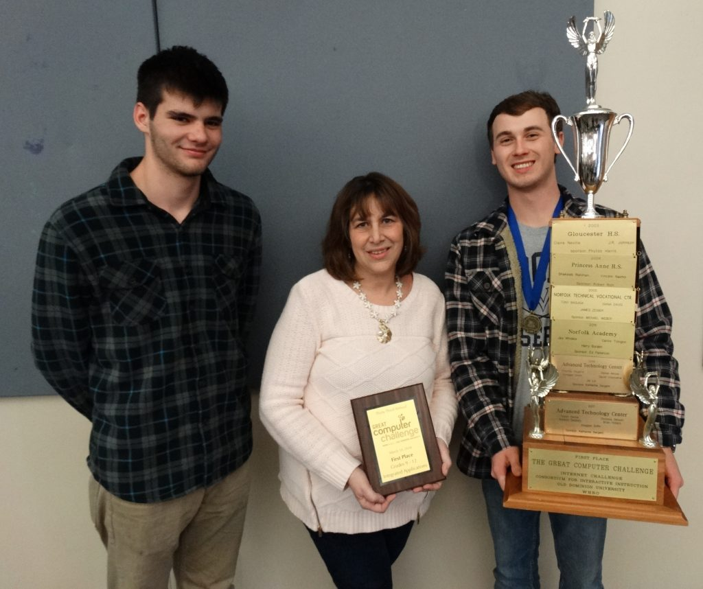 ATC students show trophy that they won at the Great Computer Challenge