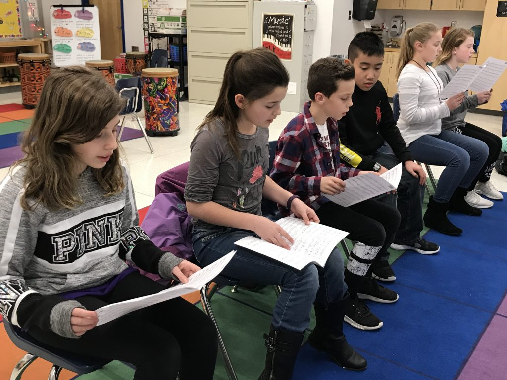 students rehearsing for the all city chorus