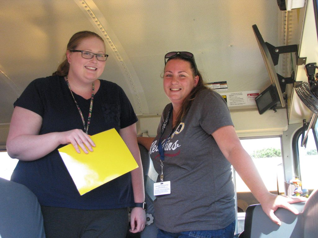 DSES teacher Ellie Thompson and bus driver Morgan Glass prepare for dismissal