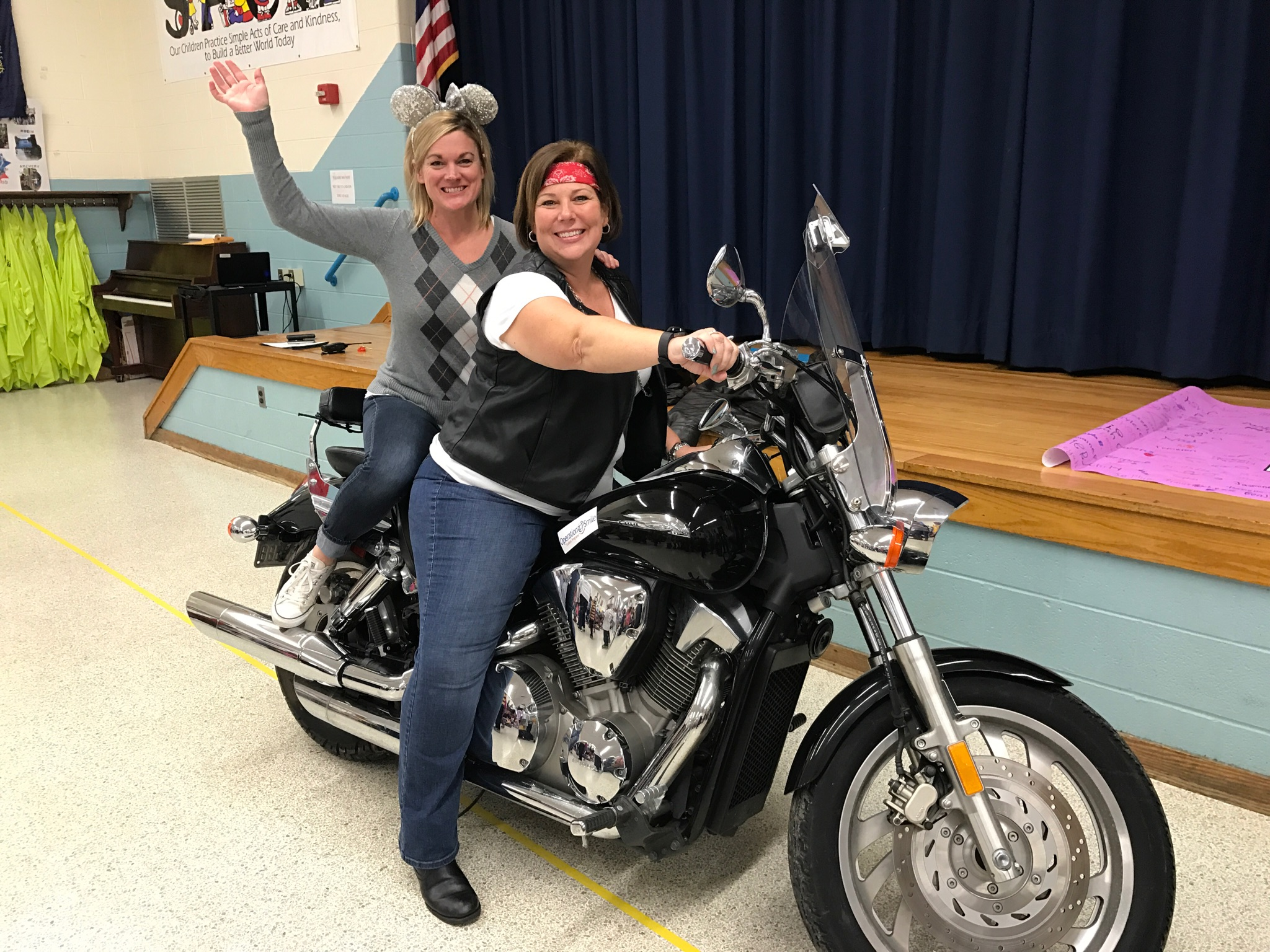 Principals Week cari hall on motorcycle