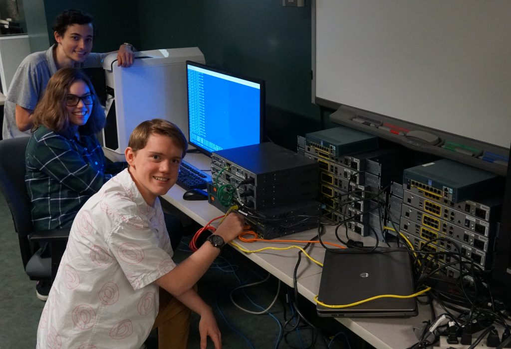 ATC Cisco Network Engineering II students Will Peachy, Lyza Munoz and Evan Millard learn how to program and manage Cisco routers and switches for an enterprise network.