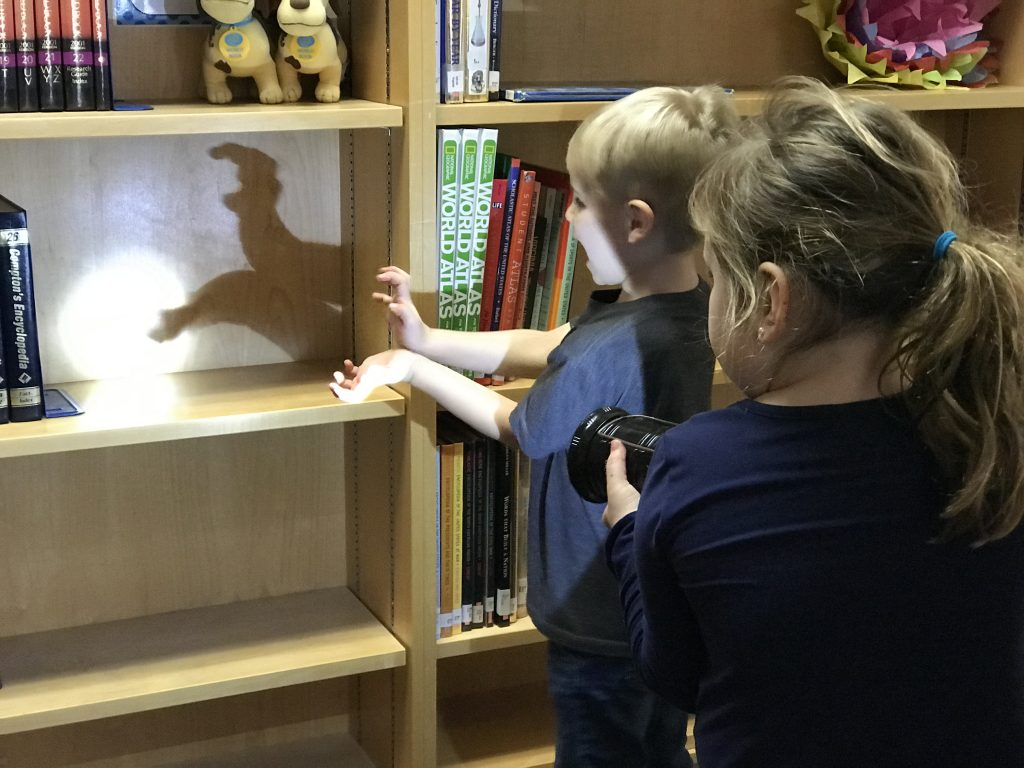 Arrowhead Elementary School kindergartners James Allen and Savvi Grogan were inspired to make shadows after reading What's That Shadow.