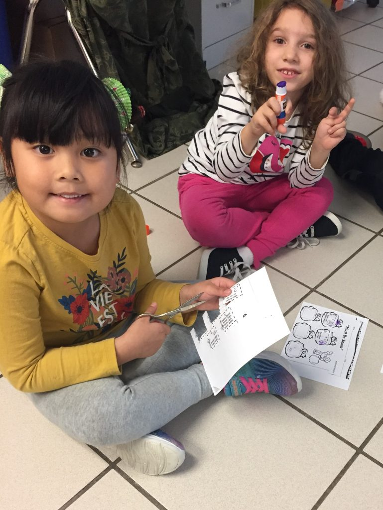 Brookwood Elementary School students Rozanne Asrturas and Grace Perez worked on sequencing with holiday songs