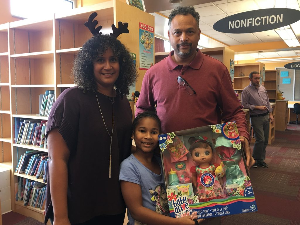 Stacy Lopez with From One Hand to Another (FOHTA) stopped by College Park to drop off toys for more than fifty students.