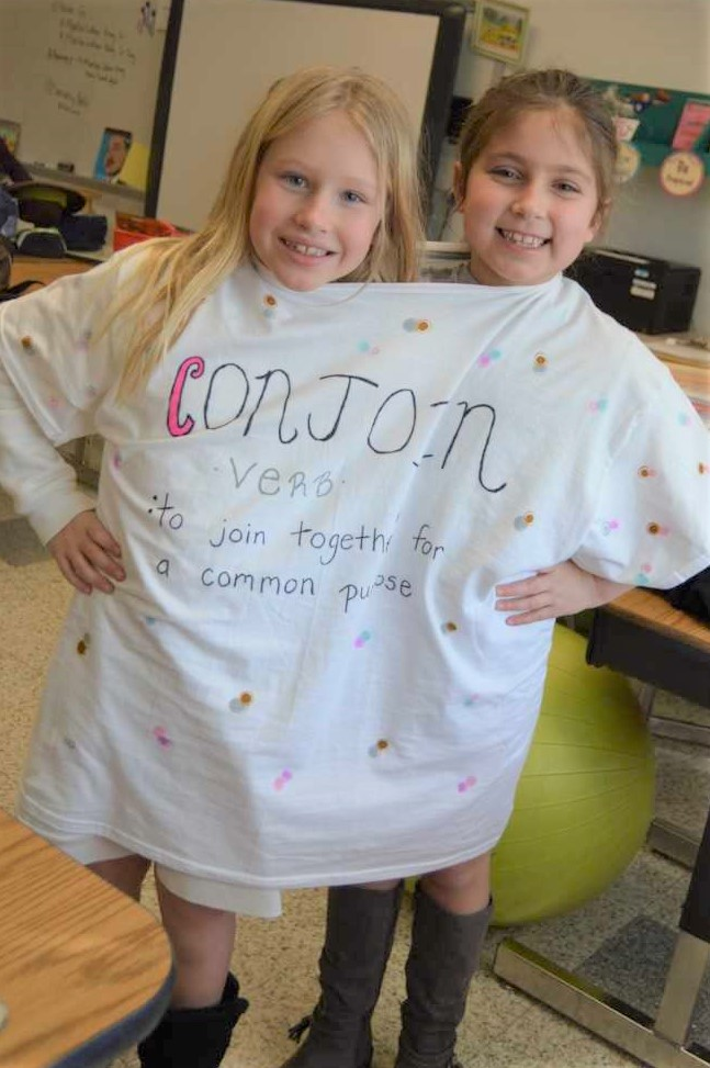 """Second-grade students and best friends Madison Lawver and Finley Keever chose the word """"conjoin"""" to represent in the Cooke Elementary School Vocabulary Parade for Reading Month."""