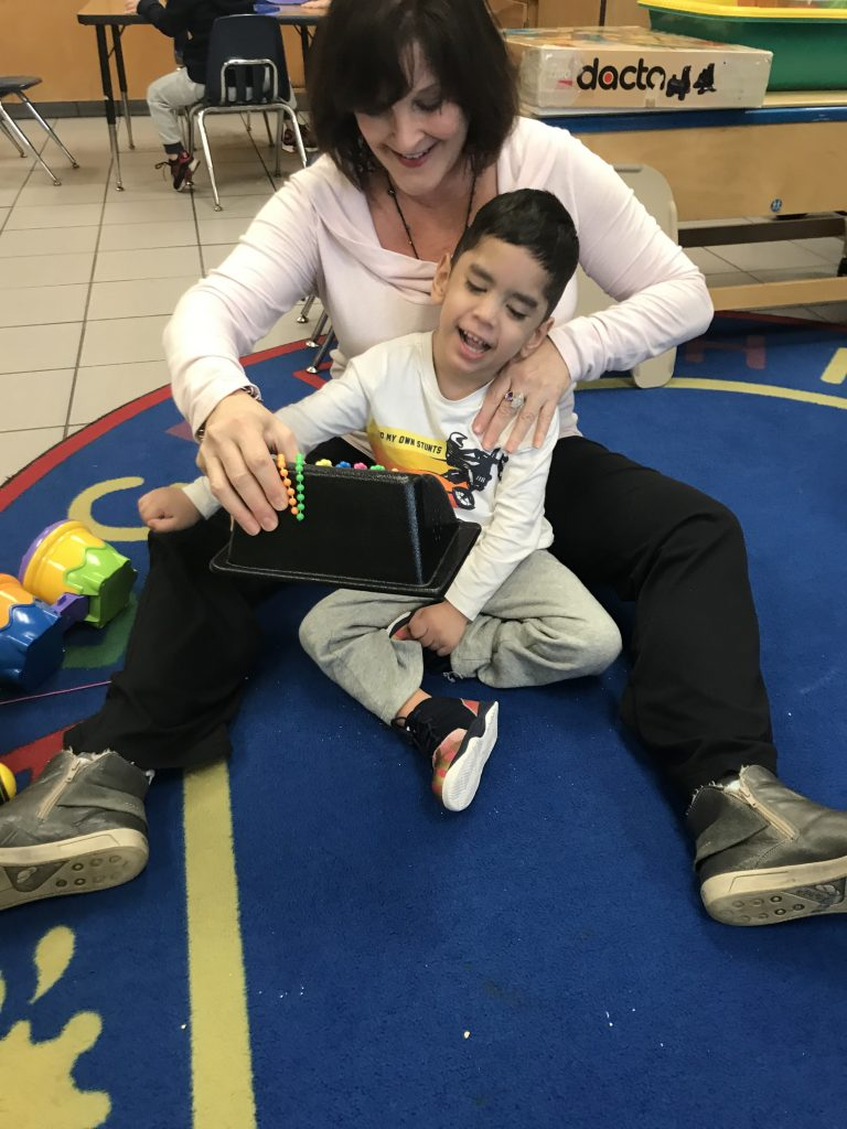 Corporate Landing Elementary School's Daniel Bebeau worked on motor skills with physical therapist Wendy Jaffe.
