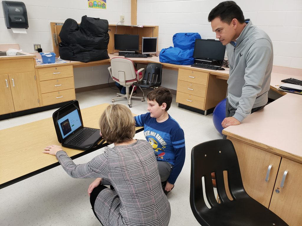 Corporate Landing Middle School sixth-grader Connor Rose showed off his tech skills to board member Victoria Manning and principal Freddie Alarcon, Jr.