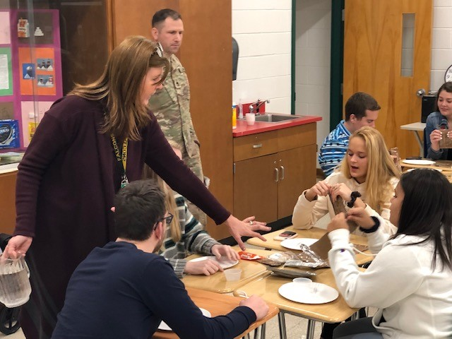 VA Army National Guard Career Counselor and Recruiter Staff Sergeant Shawn Bartz visited the Culinary Arts Class at Cox High School to give a 'Career Direction' presentation. Students got to try MREs or Meals Ready to Eat.