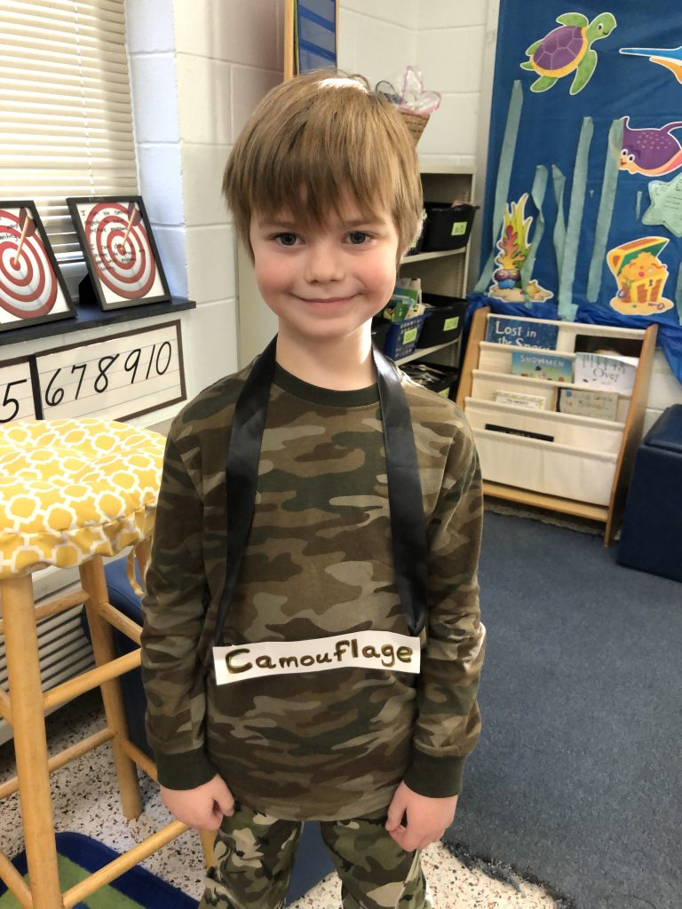 Creeds Elementary School's Walong Bernard dressed like a word in honor of Reading Month.