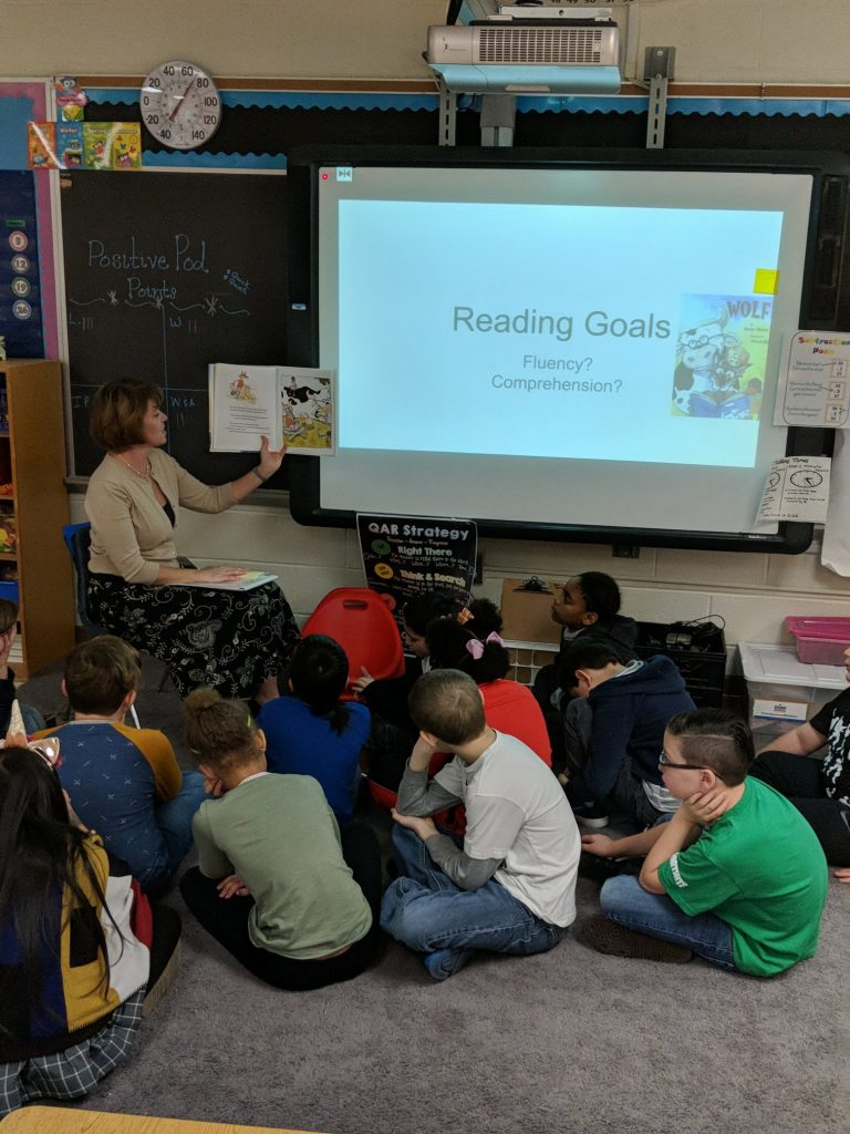 Glenwood Elementary School third- graders enjoy listening to their assistant principal Jennifer Haws read to them for reading month.