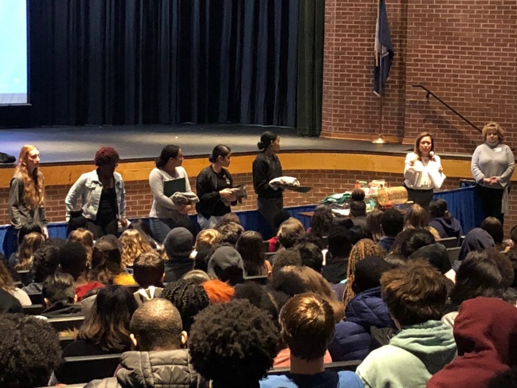 """During Green Run Collegiate's #TheGRCWay assembly four students and two teachers were awarded with certificates and spirit wear for demonstrating the """"caring"""" trait."""