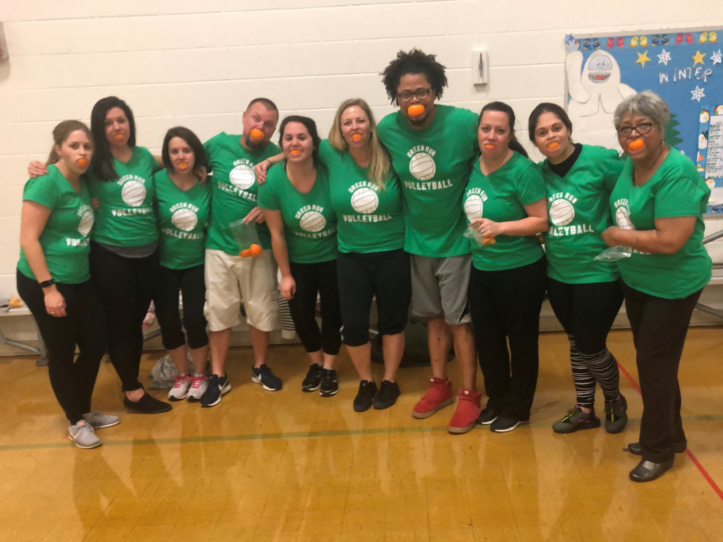 The Green Run Elementary School volleyball team celebrated their first game with oranges.