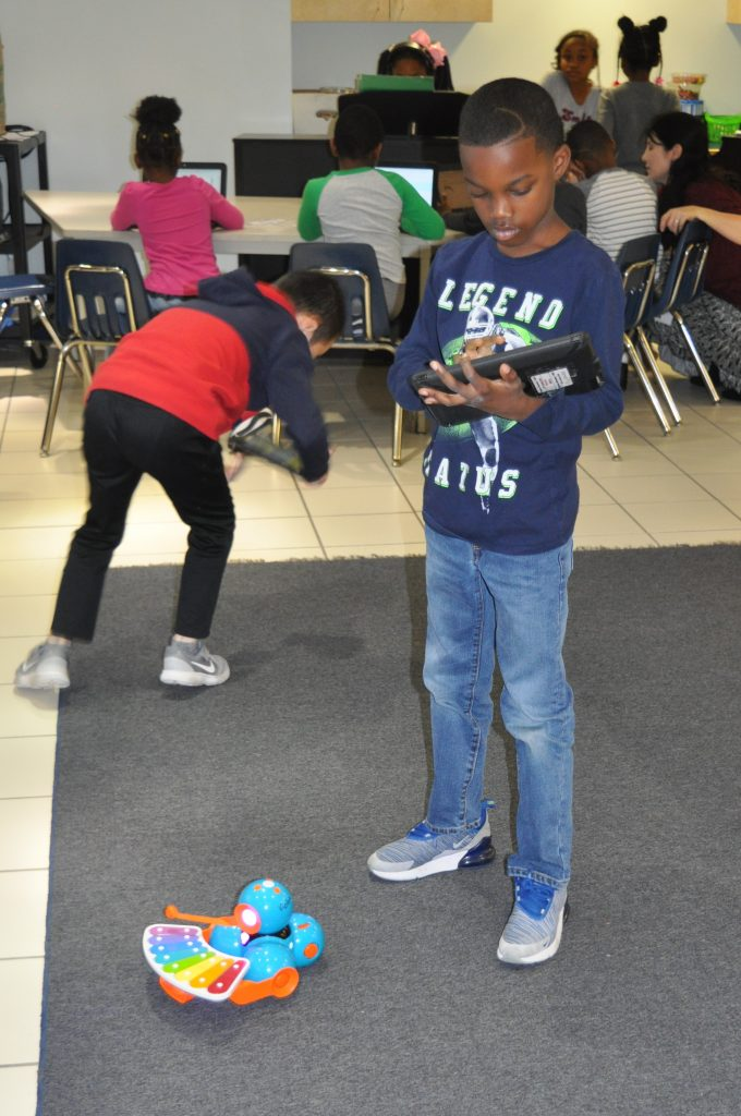 Newtown Elementary's Noah Patrice combined coding with creating music using an iPad and a Dash robot.