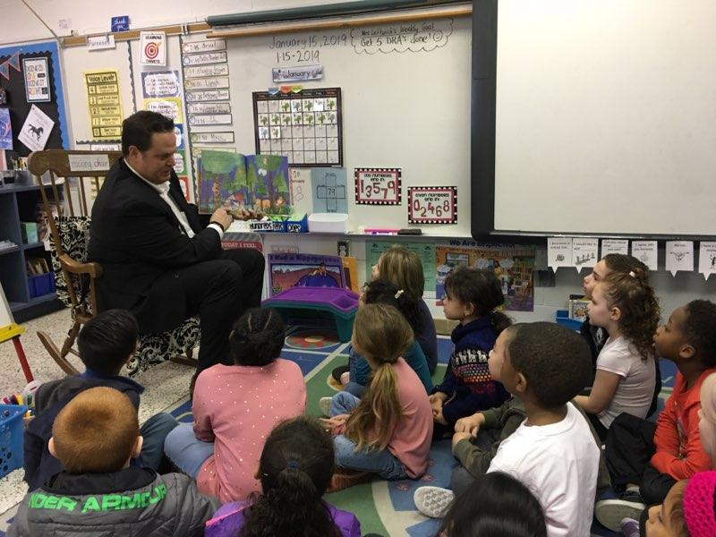 Dr. Aaron Spence read to Pembroke Elementary School first-graders.