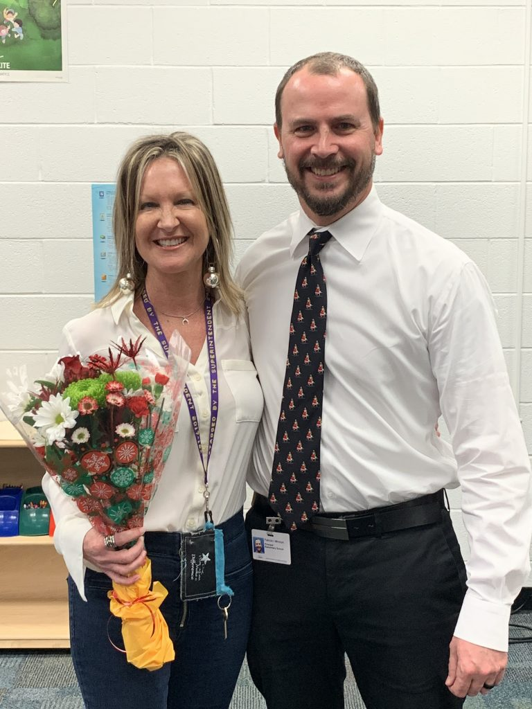 Princess Anne Elementary School Principal Ivy Wroton congratulated the school's Teacher of the Year, Lisa Powers.