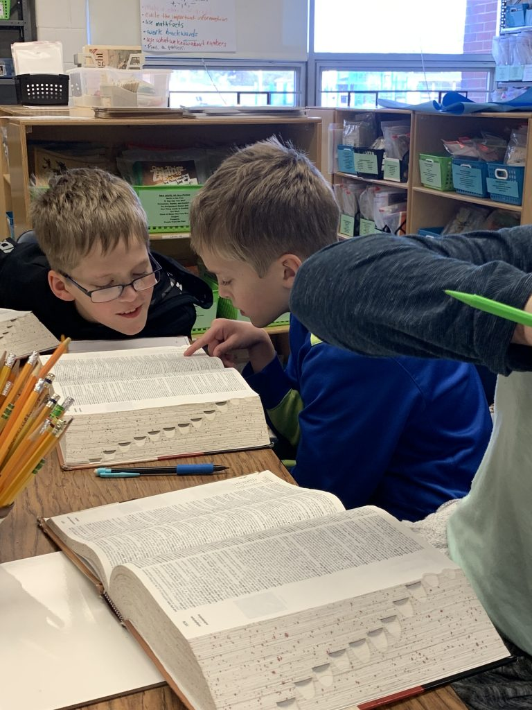 Providence Elementary School's Jack and Bill Samples really dug into the dictionary during a lesson with vocabulary.