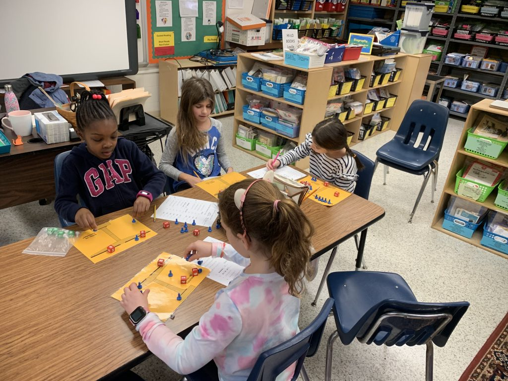 Providence Elementary students Brittyn Sellitti, Samantha Schill, Addie Savoie, and Alivia Wallace collaboratively worked through problem solving equations.