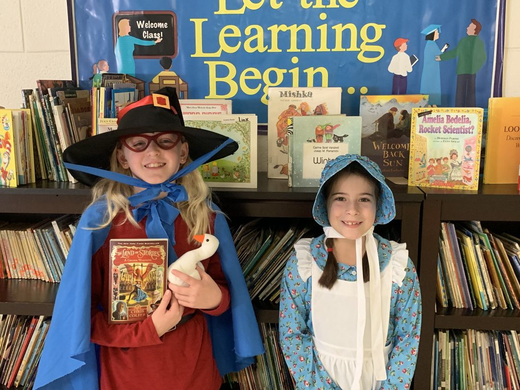 Claire Scully and Addie Savoie dressed up as Mother Goose and Laura Ingalls Wilder for Character Dress-up Day at Providence Elementary School.