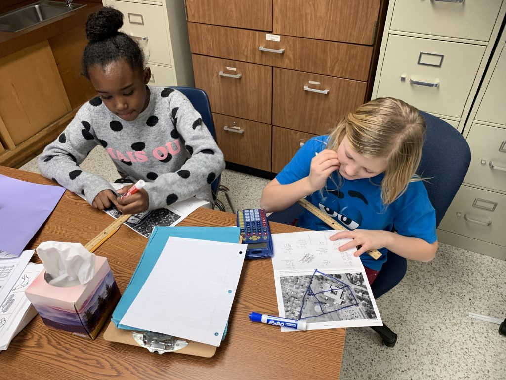 Providence Elementary School fourth-grade students Jayla Teasley and Amy Bluhm participated in OWN-ITT competition that focuses on creating a cleaner storm water system to help the watershed.