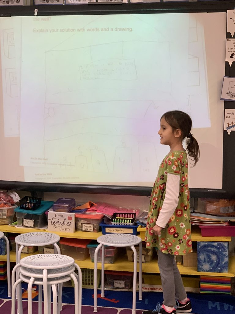 Meliha Weast showed off her strategies for a math exemplar after participating in a Math Congress.