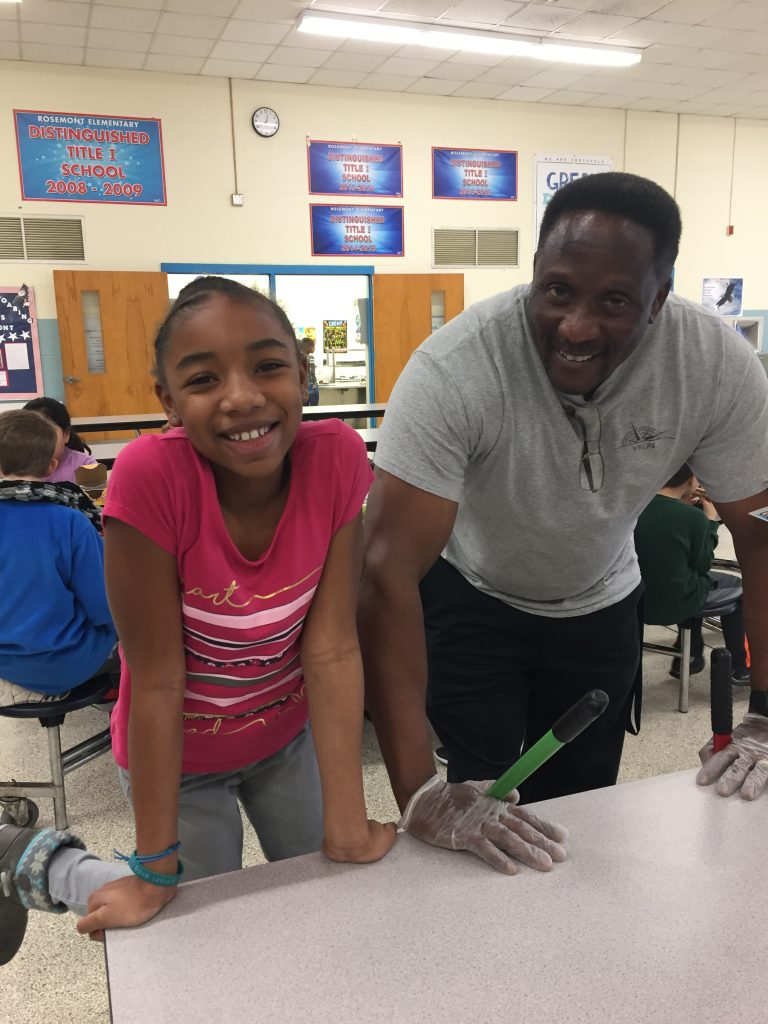 Rosemont Elementary School fourth-grader Janylah Brown shared a laugh with Head Custodian Mr. Harper after lunch