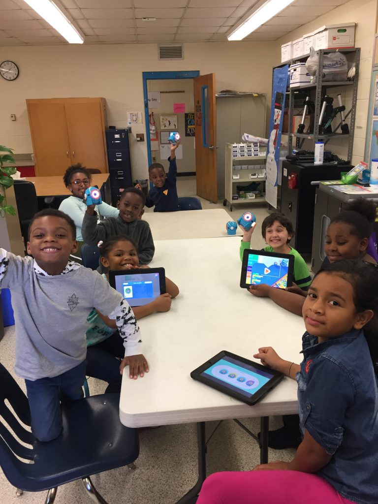 Rosemont Elementary School fifth-graders and kindergartners worked together on iPads to program robots.