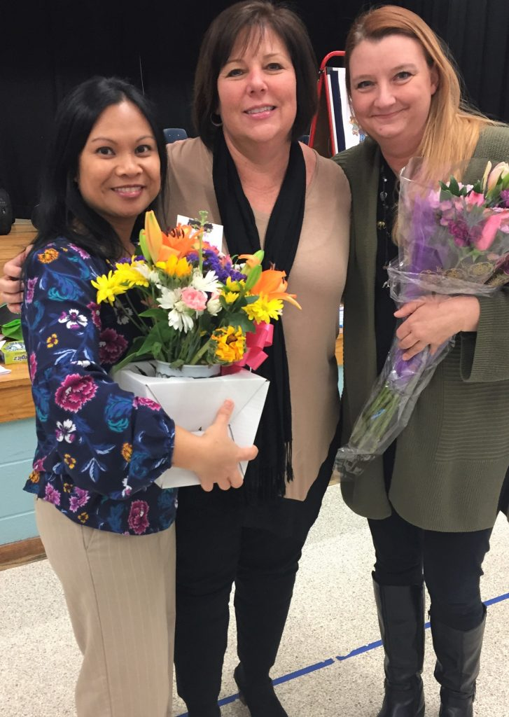 Rosemont Elementary School's Principal Cari Hall congratulates Maryanne Kowalski (left) and Tammy Clinton (right). Kowalski was named Teacher of the Year, and Clinton was named Distinguished Educator.