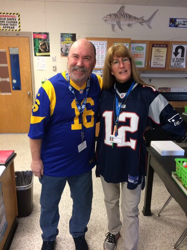 Salem Middle School teachers Dana Sauvageau and Ken Allgor displayed school spirit and who they think will win the Superbowl.