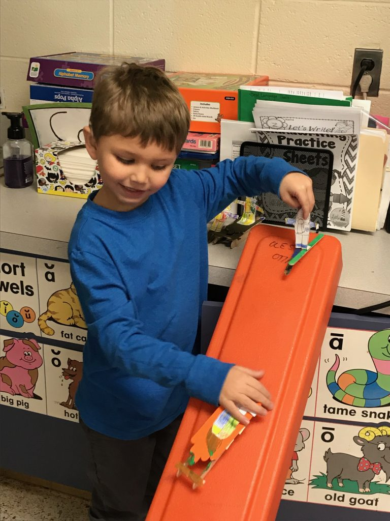Skylar Peele, kindergartner in the Oral Language Deaf Ed Program at Ocean Lakes Elementary, made skis and sleds and raced them to see which was faster.