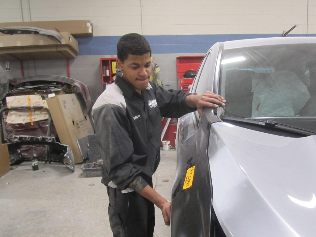 Phillipe Rivera, an Auto Body II student from the Tech Center, utilizies the skills that he learned toward an internship at Rick Hendrick Chevrolet in Norfolk.