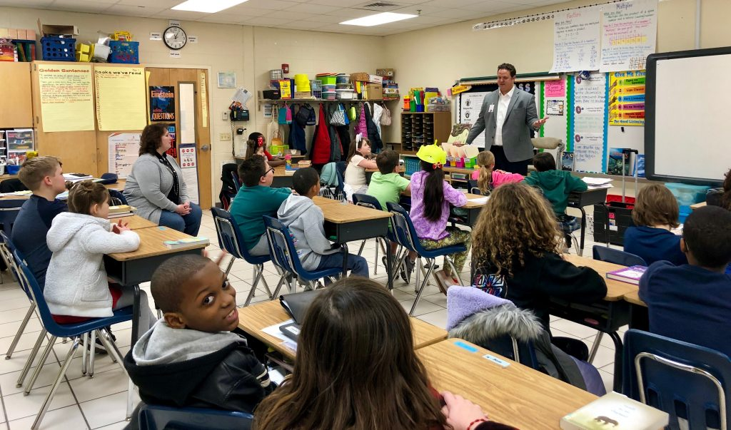 Dr. Aaron Spence visited Windsor Woods Elementary School to read to Michelle Rousselow's fourth-grade class.