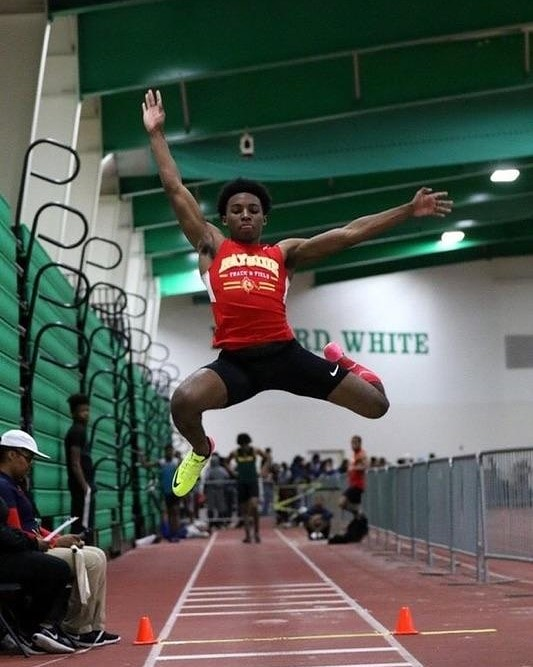 Bayside High School's Abraham Evans is the 6A Regional Champion on the Long Jump. He jumped 22 ft and 8.75 inches.