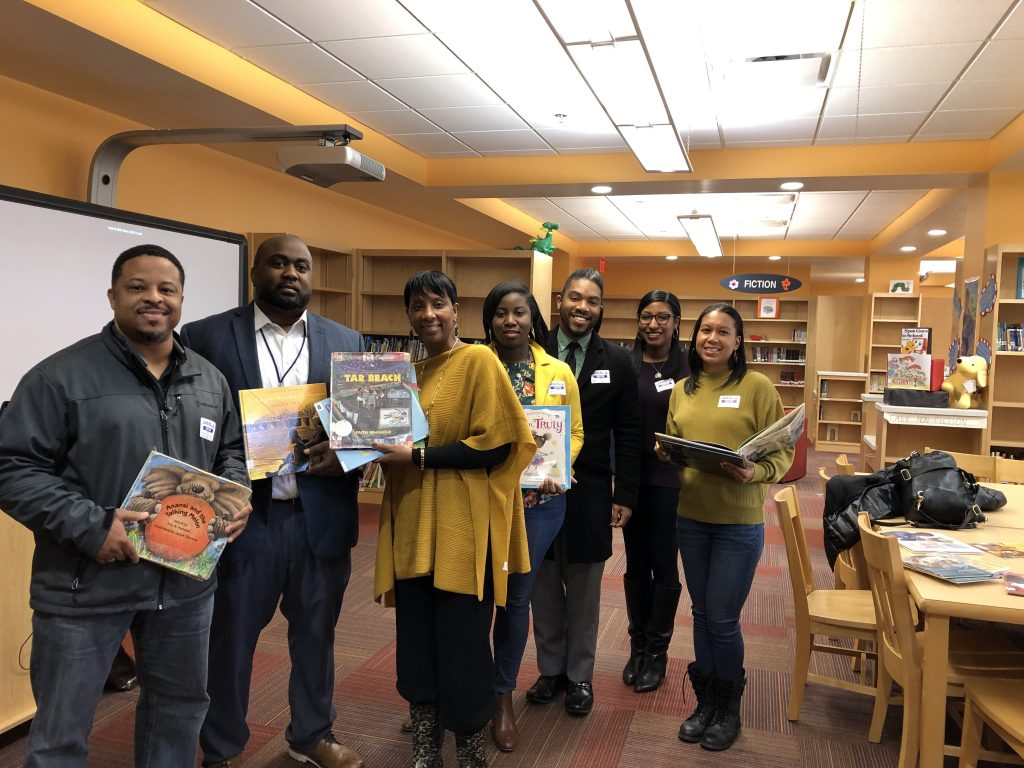 Bryan Ryals, Lindsey Anderson, Jerlaunda Wilson-Boulware, Naquana Jenkins-Huff, Christian Martin, Kara Dixon and Cara Greenwood participated in College Park Elementary School's first African American Read-In.