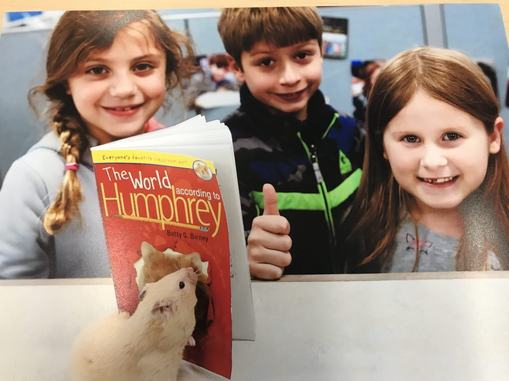 Humphrey the hamster posed with one of his books and London Foglia, Sam Zitnik and Eleanora Landa. All John B Dey Elementary School students read The World According to Humphrey as part of the One Book, One School initiative.