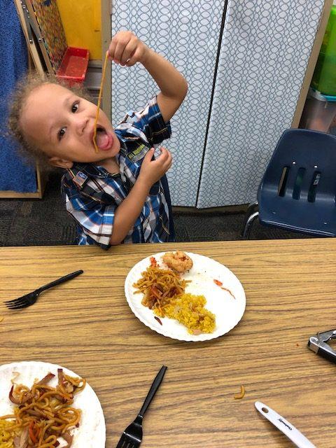 Green Run Elementary preschooler Dennis Hooks enjoyed Chinese food while celebrating the Chinese New Year.