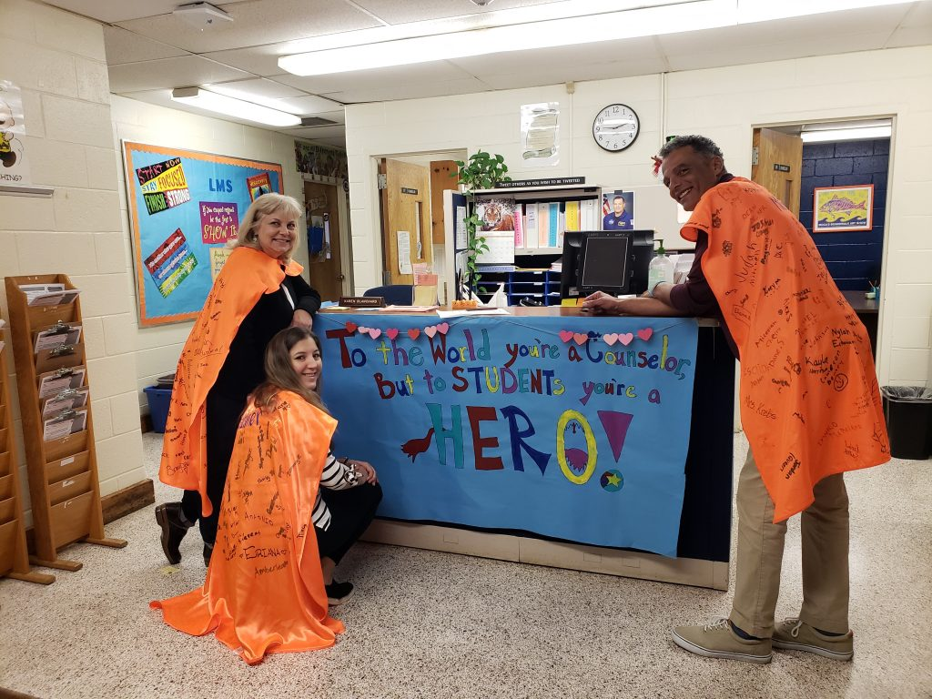 Lynnhaven Middle School guidance counselors Lisa Stephens, Julie Helmer and Ed McClendon received hero capes signed by their students