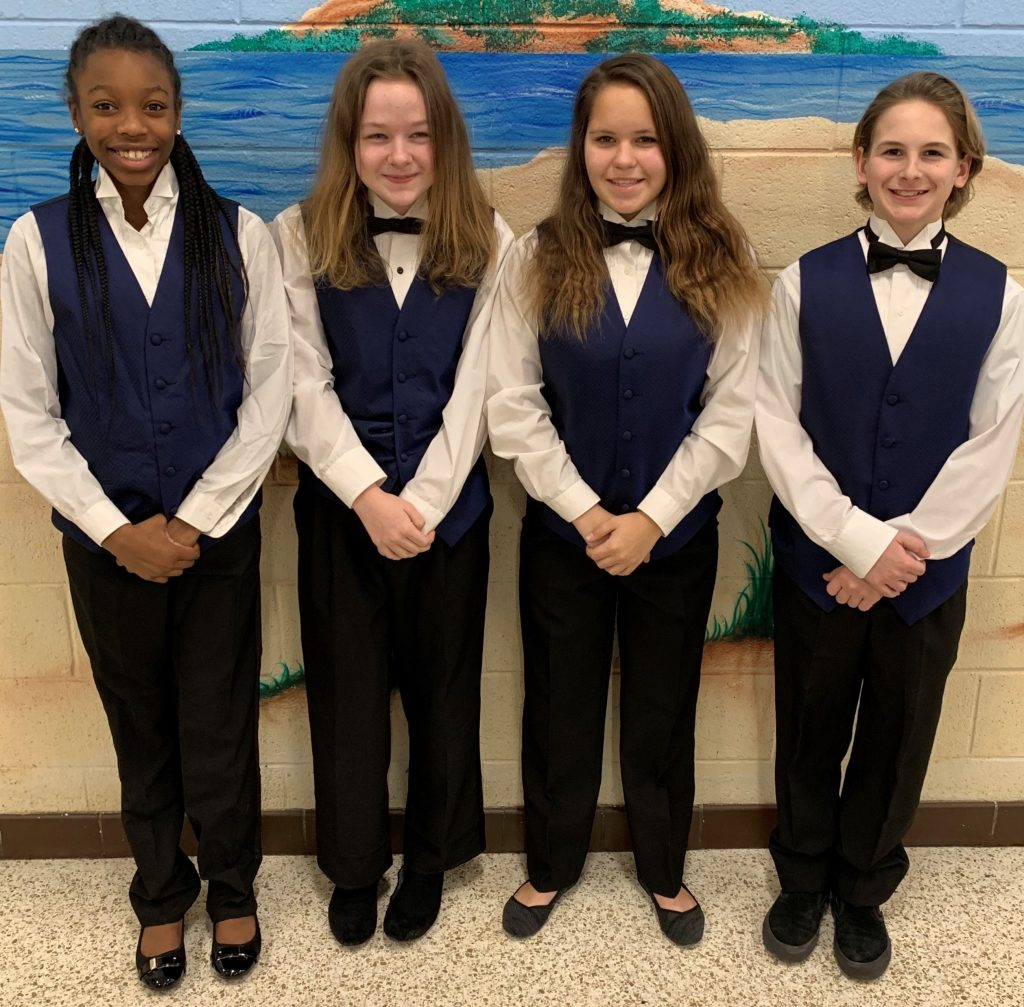 Lynnhaven Middle School students Khalani Griffin, Lindsey Kester, Alina Wills and Matthew Crawley got ready for their band performance.