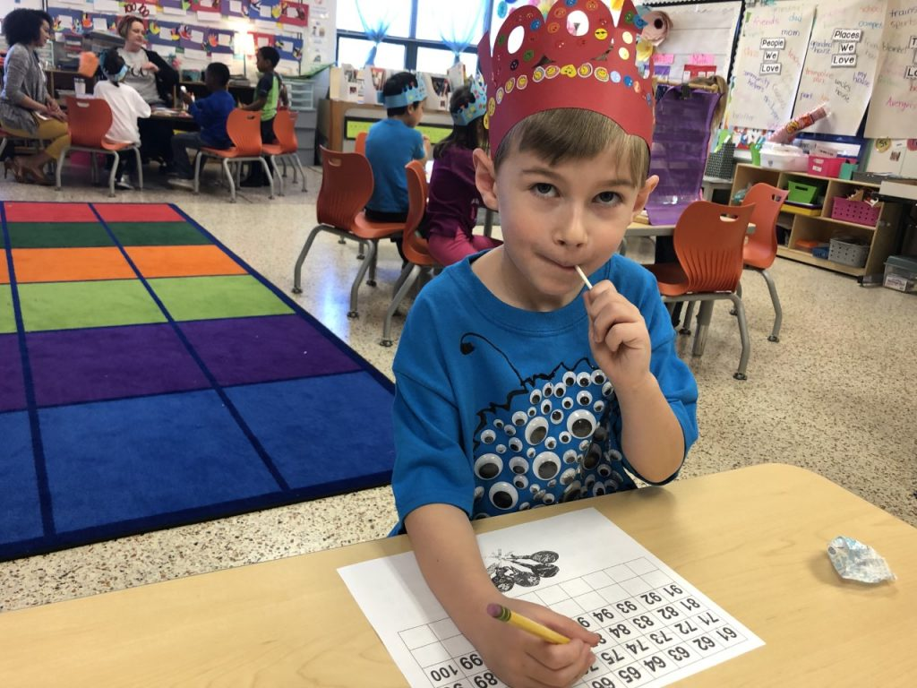 Jackson Geyer at Malibu Elementary conducts research for the 100th day of school: How many licks does it take to get to the center of a lollipop?