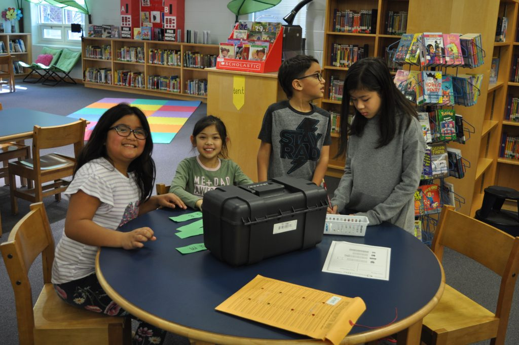 Newtown Elementary School students Khiandra Pascasio, Francheska Hidalgo, Abdielle Santiago-Felix and Jiane Canlas tried their hand a breaking out of the box.