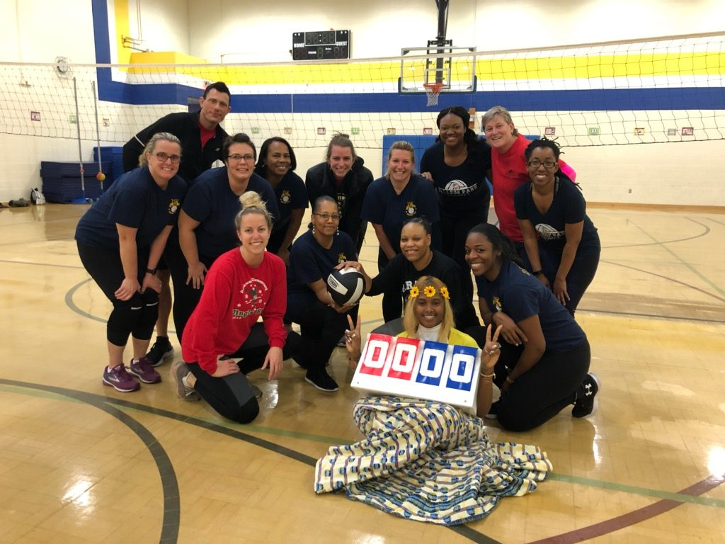Parkway Elementary School staff played College Park Elementary staff in a volleyball game.