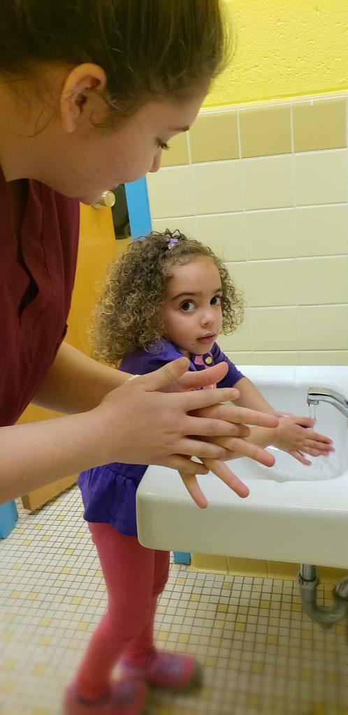 Practical Nursing II student Trinity Madison and preschooler Autumn Wild practiced good hand-washing technique.